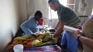 DAY 10 4 Kirill examines patient at Mulago hospital
