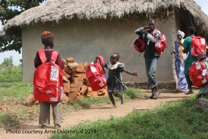 Girl running with Kinder Kit Uganda