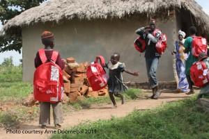 Girl running with Kinder Kit Uganda